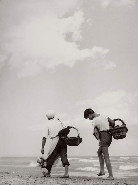 Young boys selling products on the beach in Italy, 30's, 40's, black and white photo