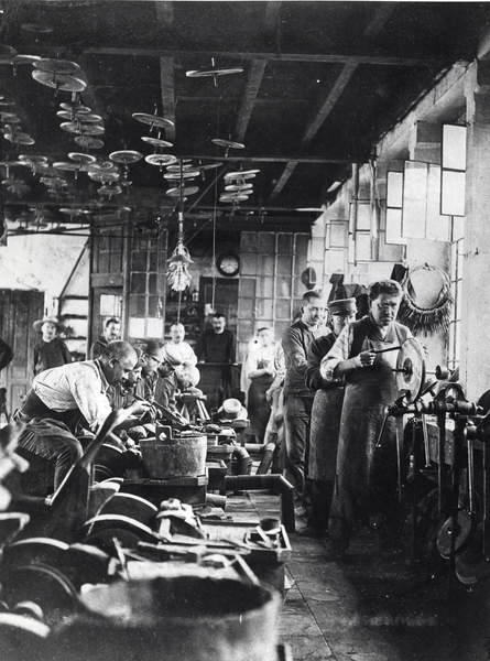 photo of Cutlers at work in the workshop, France, late 19th century (b/w photo), French Photographer, (19th century) / © Archives Charmet / Bridgeman Images