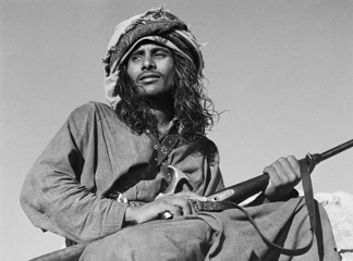Seated portrait of Salim bin Ghabaisha, one of Wilfred Thesiger's Bedouin companions, in Ras Al Khaimah Emirate, United Arab Emirates, March – April 1950 (b/w photo), Wilfred Patrick Thesiger, (1910-2003) / Pitt Rivers Museum, Oxford, UK