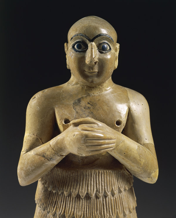 Statue of a man praying, artefact from Mari (now Tell Hariri) archeological site/ Syria, Assyrian civilization, 3rd Millennium BC/ De Agostini Picture Library/ Bridgeman Images