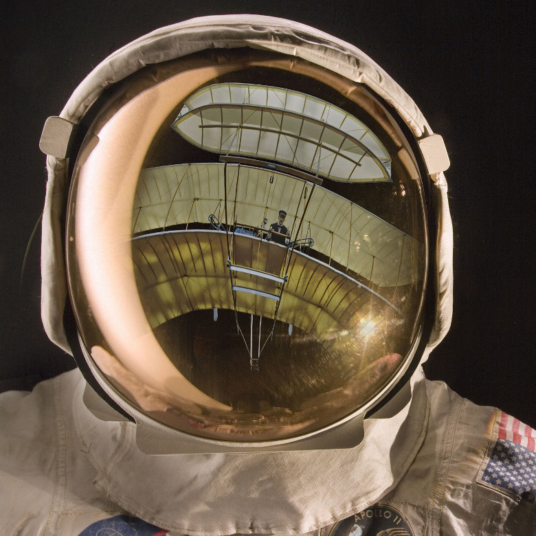 Apollo helmet visor reflecting the 1903 Wright Flyer / National Air and Space Museum, Smithsonian Institution / Bridgeman Images