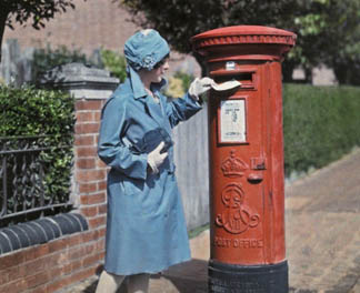 A young woman mails a letter at the pillar box, Oxford, 1928 (autochrome) by Clifton R Adams (fl.c. 1930) National Geographic Image Collection