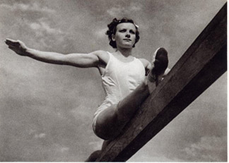 Gymnast on the balance beam, Olympic Games 1936, printed by Deutschen Verlag, 1937 by Leni  Riefenstahl (1902-2003)