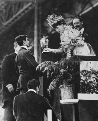 Queen Alexandra handing a special cup to Dorando to commemorate his great effort to win the Olympic marathon in July, 1908 (b/w photo) by Thomas E. and Horace Grant