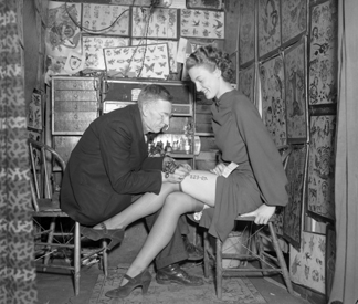 DPL415468 Woman getting a tattoo, c. 1934 (b/w photo) by Harry Melon Rhoads/ Denver Public Library, Western History Collection