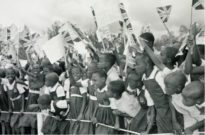 Schoolchildren waving flags for the visit of the Queen Mother, Eldoret, Kenya, 14th February 1959 (b/w photo), Charles Trotter (fl.c.1950s) © British Empire and Commonwealth Museum, UK