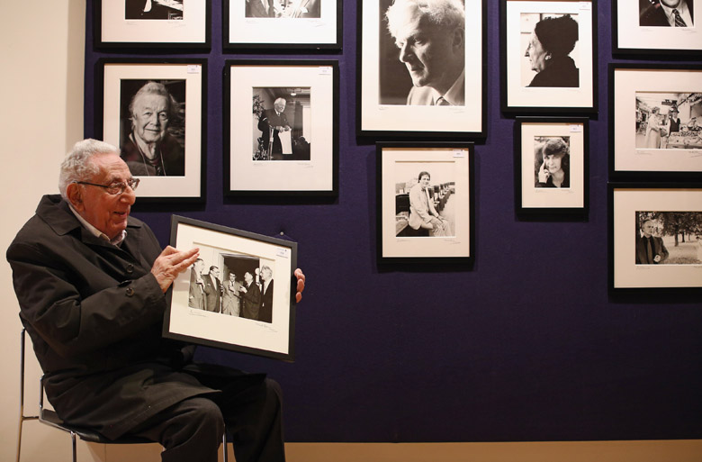 Photographer Mark Gerson, 92, poses for a picture with a selection of his images of writers in Bonhams auction house on April 8, 2013 in London/Getty