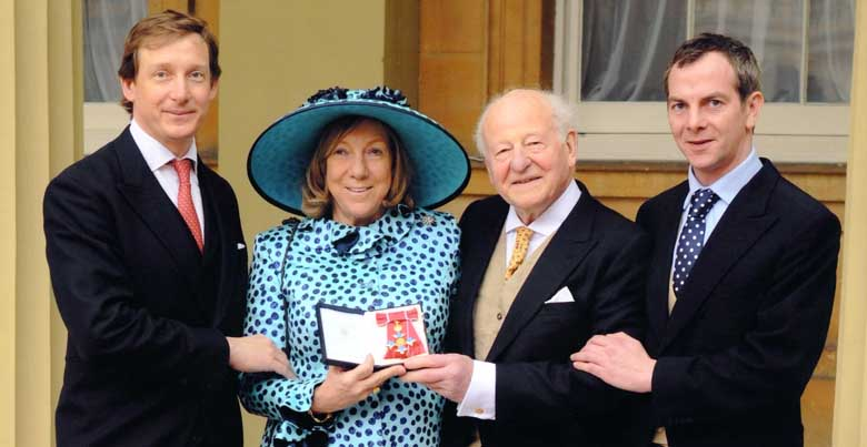 Harriet Bridgeman, her husband Robin and their sons Luke and Esmond at the Investiture ceremony, Buckingham Palace, 4 March 2014.
