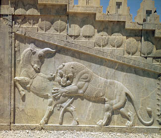 Lion fighting a bull, relief on the east staircase of the Apadana, Achaemanian Period, c.515 (stone), Achaemenid, (550-330 BC) / Persepolis, Iran / Giraudon