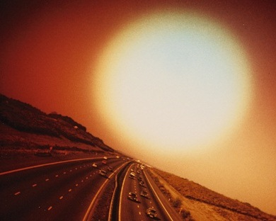 Giant Sun over Expressway by John Cooper (b.1939) © Special Photographers Archive/ out of copyright