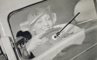 STC245485 A woman driving, c. 1930s by Czech Photographer, Private Collection/ The Stapleton Collection