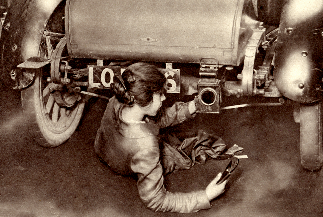 photo of woman working on a car during WW1
